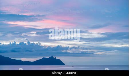 Calm, peaceful sunset view over the beach and South China Sea from Bako National Park, Sarawak, Borneo - Stock Photo