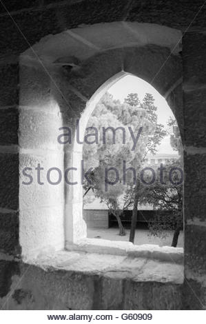 A window looking out over Castelo sao Jorge in Lisbon, Portugal. - Stock Photo