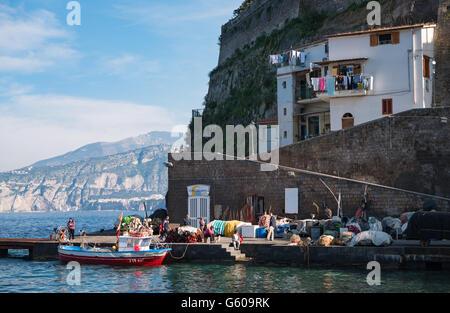 Italy, Sorrento, fishermen and tourists in Marina Grande - Stock Photo