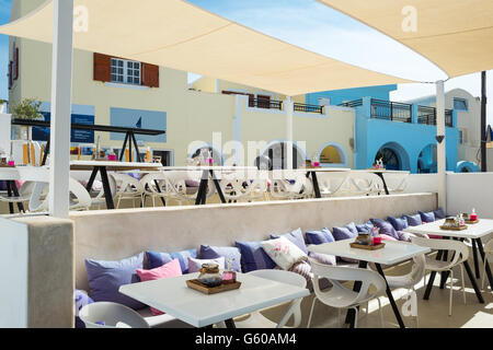 Greece, Santorini island, Fira, a bar restaurant on the caldera pathway - Stock Photo