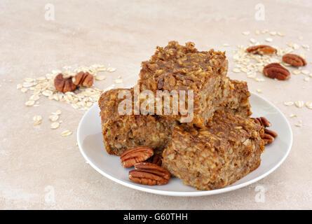 Fresh, healthy and homemade pumpkin pecan oatmeal snack bars. - Stock Photo