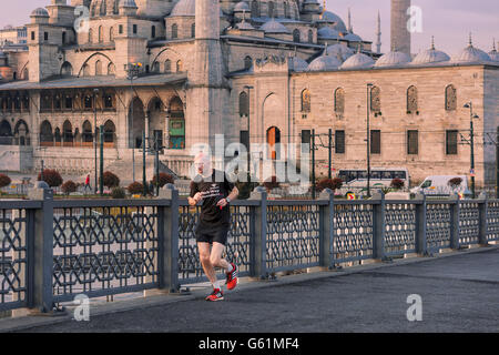Man jogging early in the morning in Istanbul. - Stock Photo