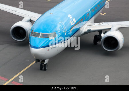 AMSTERDAM,HOLLAND - FEBRUARY 23, 2014  Front of a just arrived blue klm passenger plane on shiphol airport - Stock Photo