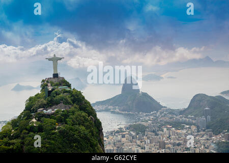 UNESCO World Heritage Listed landscape of Rio de Janeiro, with Christ the Redeemer (Cristo Redentor) statue and - Stock Photo