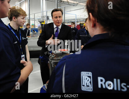 Prime Minister David Cameron meets apprentices during a visit to Rolls Royce Learning and Career Development Centre - Stock Photo