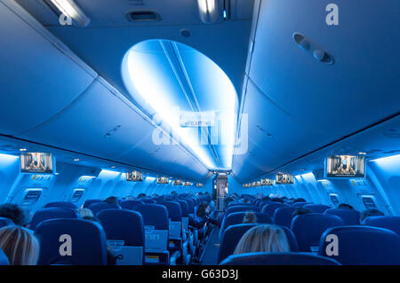 Interior of TUI Airways Boeing 737-800 aircraft at North Terminal, London Gatwick Airport, Crawley, West Sussex, - Stock Photo