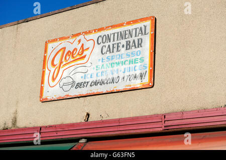 Joe's Continental coffee house sign on Commercial Street, Little Italy, Vancouver, British Columbia, Canada - Stock Photo