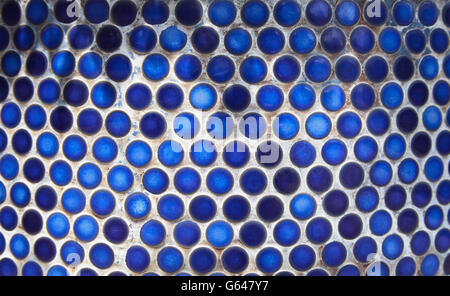 Blue penny circular ceramic tiles background. Tiled indigo color bathroom wall - Stock Photo