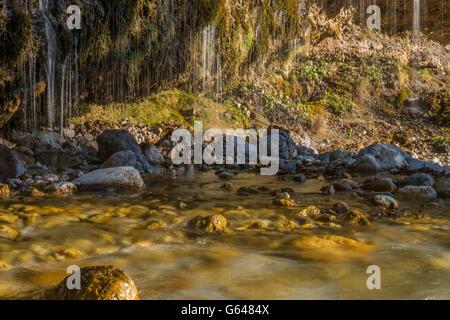 Water curtain in Maria Alm, Austria - Stock Photo
