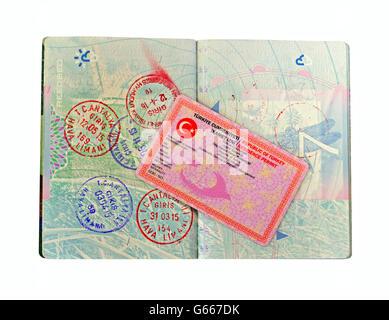 British passport and Turkish residence visa isolated on white - Stock Photo