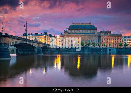 Prague. Image of Prague riverside with reflection of the city in Vltava River and National Theatre. - Stock Photo