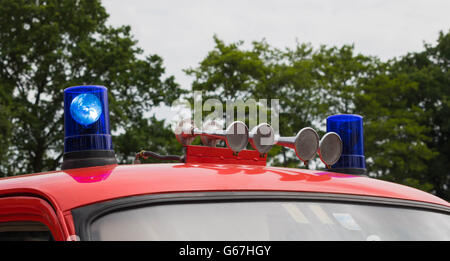 flashing blue lights and horn on a German firetruck - Stock Photo