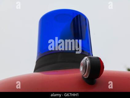 blue  light on a German firetruck - Stock Photo