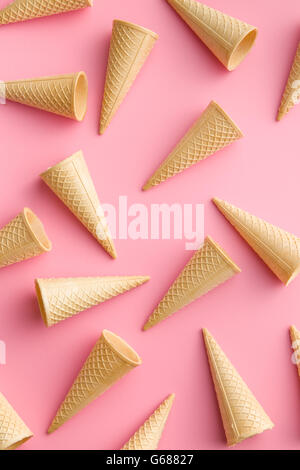Sweet wafer cones on pink background. - Stock Photo
