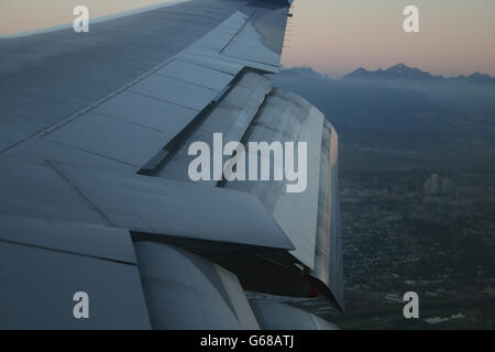 Flaps of a Boeing 747-400 operated by China Airlines, landing in Vancouver - Stock Photo