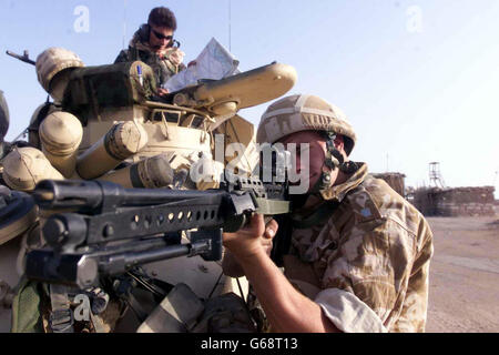 A member of the Queen's Dragoon Guards 3 Commando in Southern Iraq.