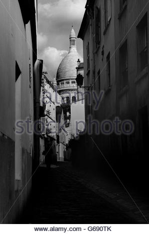 View of the Scare Coeur from an dark alleyway in Paris, France - Stock Photo