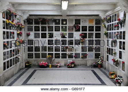 Inside Crematorium with plaques holding ashes. Pere Lachaise cemetery in Paris (III) - Stock Photo