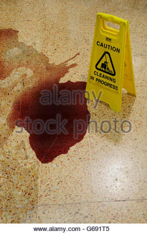 Red wine spilt on supermarket floor - Stock Photo