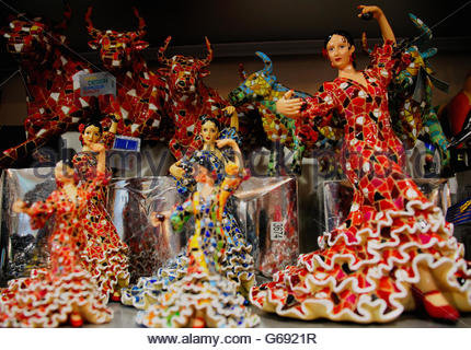 Display of Gaudi style china doll flamenco dancers and Spanish bulls in Barcelona - Stock Photo