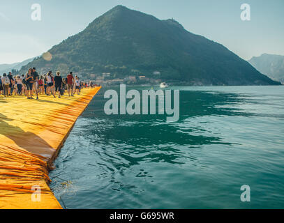 The Floating Piers Christo project. Visitors walking from Sulzano to Monte Isola and to the island of San Paolo. - Stock Photo