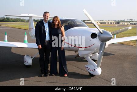 Carol Vorderman flies into Fairford - Stock Photo