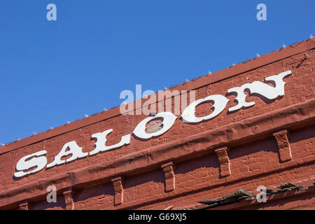 Vintage saloon letters on a red brick building in Nevada City, California - Stock Photo