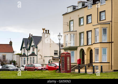 UK, County Durham, Hartlepool, Seaton Carew, houses and K6 phone box around The Green - Stock Photo