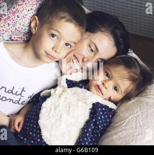 Mother with young children, portrait - Stock Photo