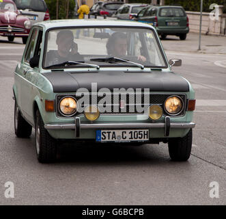 FANO, ITALY - MAY 16: fiat 128 old racing car in rally Mille Miglia 201 4 the famous italian historical race (1927 - Stock Photo