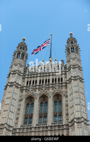 London UK.  24 June 2016.  The Union Jack flies aloft the Houses of Parliament, on the day that Britain voted to - Stock Photo