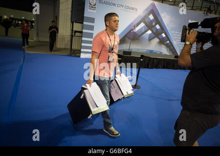 Glasgow, UK. 23rd June, 2016. The ballot boxes containing the votes arrive in the Emirates Arena to begin the count - Stock Photo