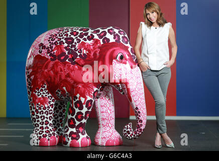 Alex Jones, presenter of BBC's The One Show, alongside Spirit, the elephant she designed in collaboration with Mercy Delta for the Elephant Parade, at BBC in London.