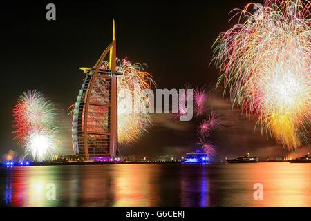 Fireworks at Burj Al Arab on New Year's , Dubai, United Arab Emirates - Stock Photo