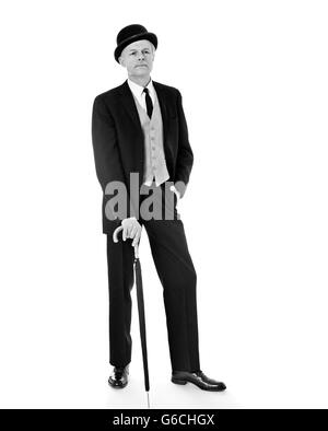 1955460dc02 ... 1960s PORTRAIT FULL LENGTH MAN WEARING THREE PIECE SUIT BOWLER HAT  HOLDING AN UMBRELLA VERY BRITISH