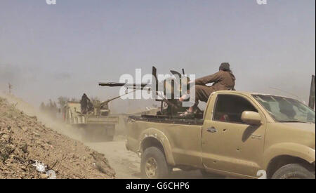 Islamic State fighter fires an anti-tank weapon during fighting in the Makhoul Mountains May 30, 2016 near Baiji, - Stock Photo