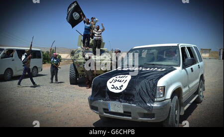Islamic State fighters celebrate after over running an Iraqi outpost April 4, 2016 in the vicinity of Zawbaa, Iraq. - Stock Photo