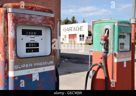 Vintage old Gas Petrol Pump Station near Garage. perfect for advertising or broshure. - Stock Photo