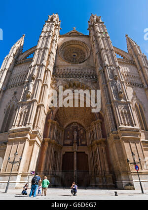 Vertical (2 picture stitch) view of the main portal on the south side of Palma Cathedral, Majorca. - Stock Photo
