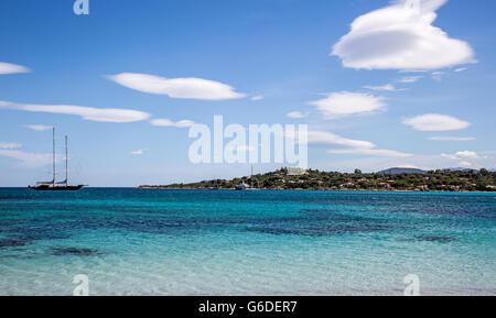 Cloud Formations On Carla Brandinchi Beach Sardinia Italy - Stock Photo