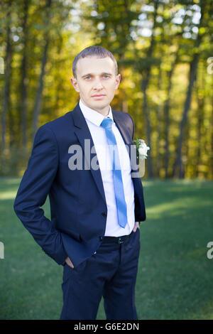 Stylish groom in suit - Stock Photo