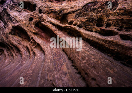 Sandstone Background Swirls and Water pockets Little Wild Horse Canyon walls close-up - Stock Photo