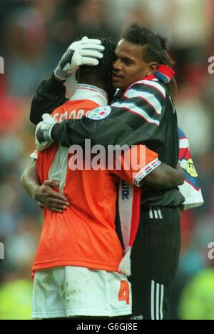 22-JUN-96. Netherlands v France. Bernard Lama of France consoles the tearful Clarence Seedorf of the Netherlands after Lama saved Seedorf's penalty