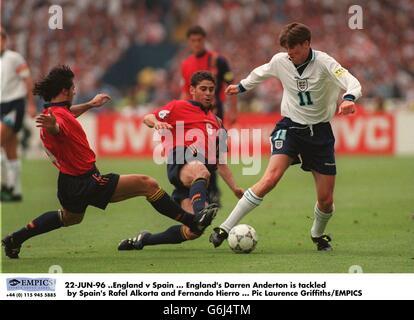 22-JUN-96 .England v Spain. England's Darren Anderton is tackled by Spain's Rafel Alkorta and Fernando Hierro