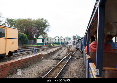 Approaching New Romney Station on the Romney, Hythe and Dymchurch Railway. - Stock Photo