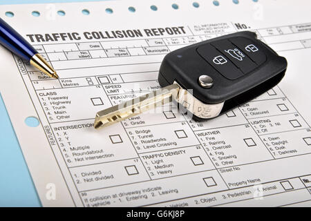 car key and collision report form with a blue pen - Stock Photo