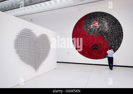 Man looking at sculpture This Call May be Recorded for Quality Service at Interior of MAXXI National Centre of Contemporary - Stock Photo