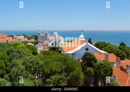 View over the Alfama district and the Tagus river shot from the Castelo de Sao Jorge - Stock Photo