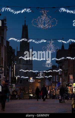 UK, Gloucestershire, Gloucester, Westgate Street, Christmas illuminations & St Nicholas' Tower - Stock Photo