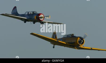 Russian Yak 52 and an American Harvard - Stock Photo